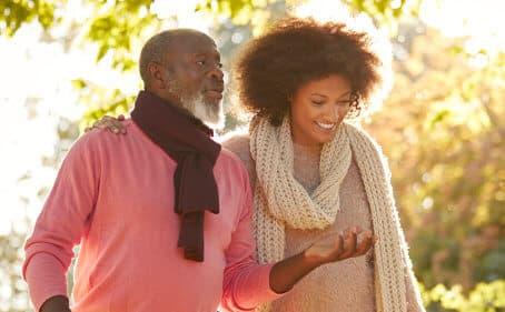 senior man and woman walking outside