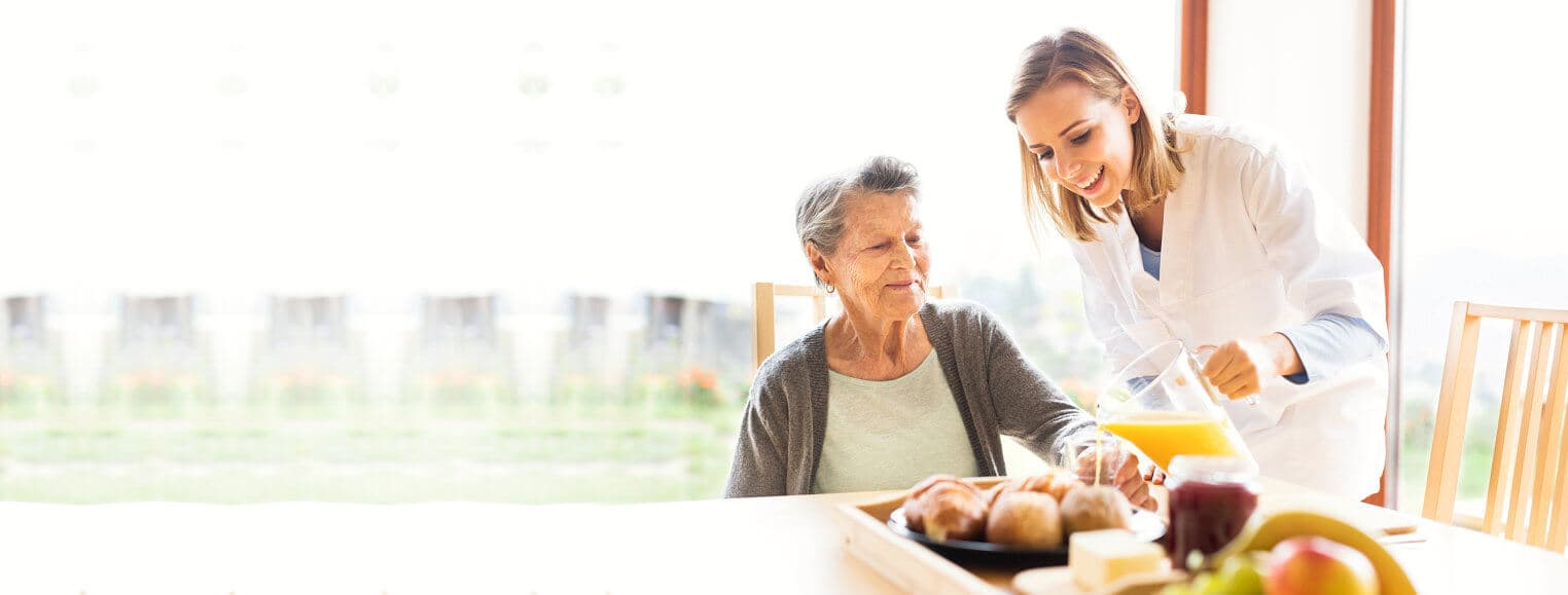 caregiver assisting for senior woman